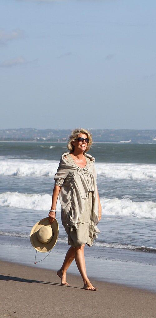 ANNIE HAAK walking along a beach